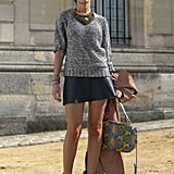 An artful mix of Fall essentials: a chunky knit, leather skirt, and perfect accents, like high-wattage booties and jewels.