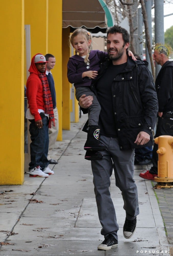 Violet Affleck wore boots decorated with peace signs on an afternoon romp around LA with Ben Affleck in December 2010.