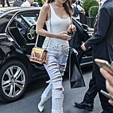 Bella Wore a White Bodysuit With Light-Wash Pants and White Booties