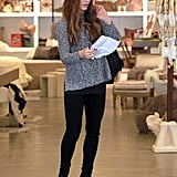 In December 2011, Kate got a jumpstart on holiday shopping in a marbled ALC sweater, black bottoms, and suede booties in Brentwood.