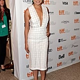 Despite the knee-length hemline, Mila Kunis made white look undeniably hot in a plunging dress at the Third Person premiere in Toronto. We loved the pop of green earrings, too.