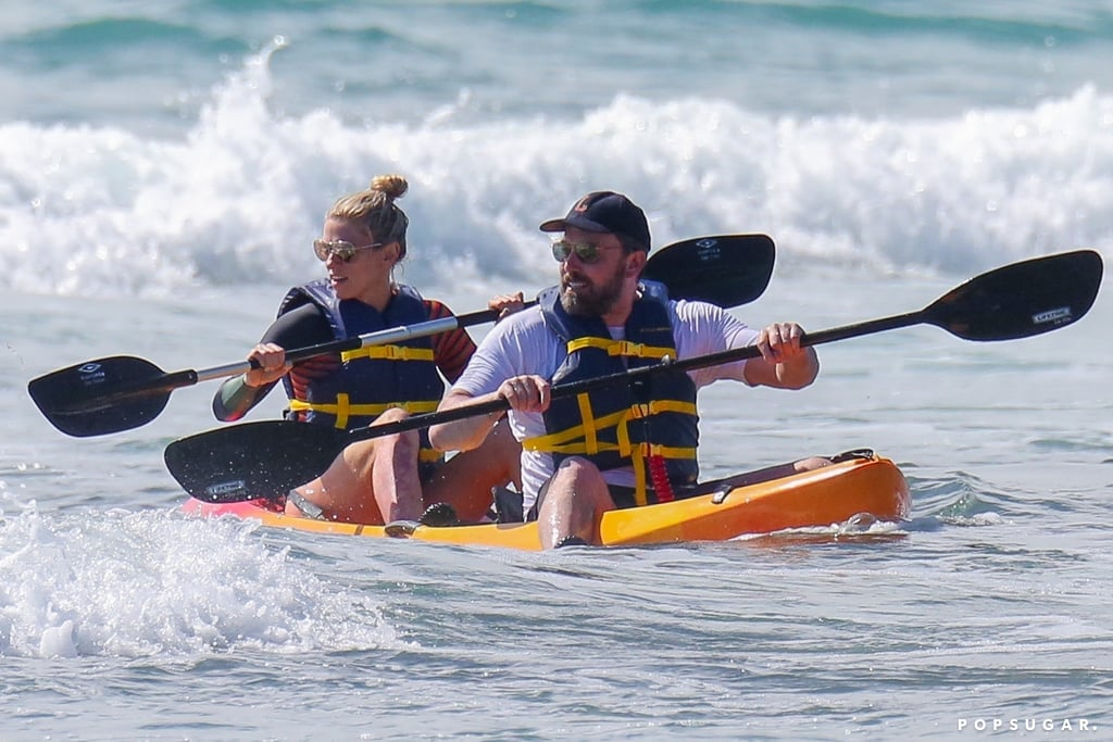 """Ben Affleck isn't letting the haters get him down. After making headlines for his massive phoenix back tattoo when he was spotted filming in Hawaii earlier this month, the actor opted to cover up when he went kayaking with girlfriend Lindsay Shookus on Tuesday. The couple, who first confirmed their romance last July, looked carefree as they paddled in the water.  The happy outing comes just on the heels of The New Yorker's satirical piece about the actor called """"The Great Sadness of Ben Affleck,"""" in which it described his colorful ink as a """"garish tattoo."""" It seems like Ben might have the last laugh, though, as he tweeted the publication back on Thursday, writing, """"@NewYorker I'm doing just fine. Thick skin bolstered by garish tattoos."""" HA! See more pictures from his not-so-shirtless outing ahead.       Related:                                                                                                           Ben Affleck's Colorful Tattoos Really Need to Be Seen to Be Believed"""