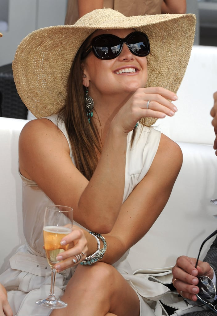 Kate Hudson sipped Champagne in a floppy hat at the Veuve Clicquot Polo Classic in NYC back in May 2009.