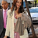 Katie Holmes carried a light sweater to her on-air appearance.