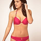 Channel a sultry Bond girl in this hot-pink belted bikini — golden gun not included. Ted Baker Pink Padded Bikini With Metal Hardware ($64, originally $116)