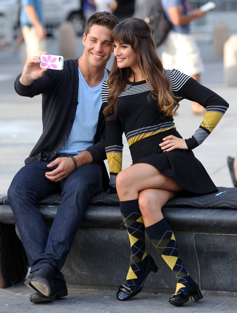 Australian singer/actor Dean Geyer cosied up to American actress Lea Michele as the pair took a break from filming Glee in Washington Square Park, New York, on August 13.