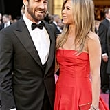 Jennifer Aniston and Justin Theroux had the look of love on their way into the event.