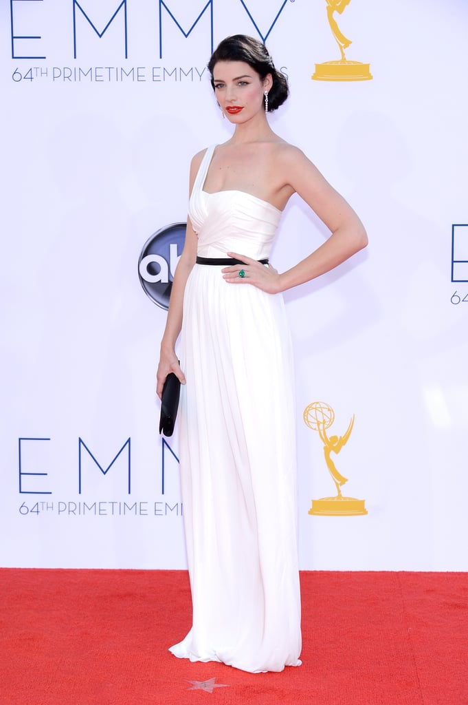Mad Men's Jessica Paré looked glamorous in a custom white Jason Wu gown on the red carpet at the Primetime Emmys in LA this evening. The series is up for multiple awards at tonight's show, including outstanding drama, which they've taken home four years in a row. We're in the middle of the action now, so make sure to watch our LIVE show.  Also, don't forget to vote on all of our Emmys polls here!
