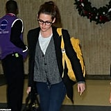 Kristen Stewart toted a yellow backpack.
