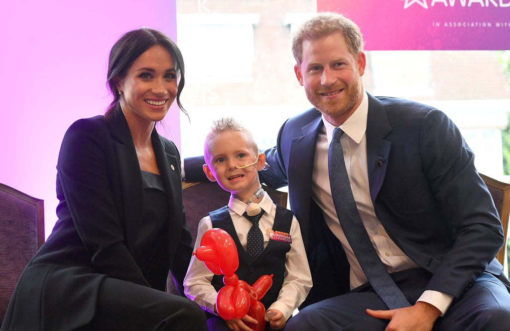 "Summer is over, and it's back to work for the British royal family! After making an appearance at a performance of Hamilton last week, Prince Harry and Meghan Markle continued to support the work of good causes as they attended the WellChild Awards in London on Tuesday. Meghan glowed in an all-black ensemble, while Harry looked handsome in a blue suit. The couple met with sick kids who were honored at the event, and Harry shared an incredibly sweet moment with a 7-year-old girl named Matilda Booth, who has spina bifida and is paralyzed from the chest down. ""He made her pinky promise to always keep that beautiful smile,"" Matila's mom, Sharon Booth, told People. Harry is patron of the children's charity and has been attending events on their behalf over the last few years. At last year's awards, we saw him bond with the incredible children nominated for awards for bravery and courage, and the only difference this year was that he brought his new wife along for the ride.       Related:                                                                                                           The Queen Only Has Sympathy For Meghan's Family Problems, and We're Glad She's Got Her Back"