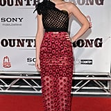 Leighton wearing a one-shouldered Marc Jacobs dress with floral appliqué for the premiere of Country Strong in 2010.