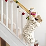 With the popularity of chunky knits on throw blankets and accent pillows, it was only a matter of time before Knitted Christmas Stockings ($82) embraced the cozy style too.