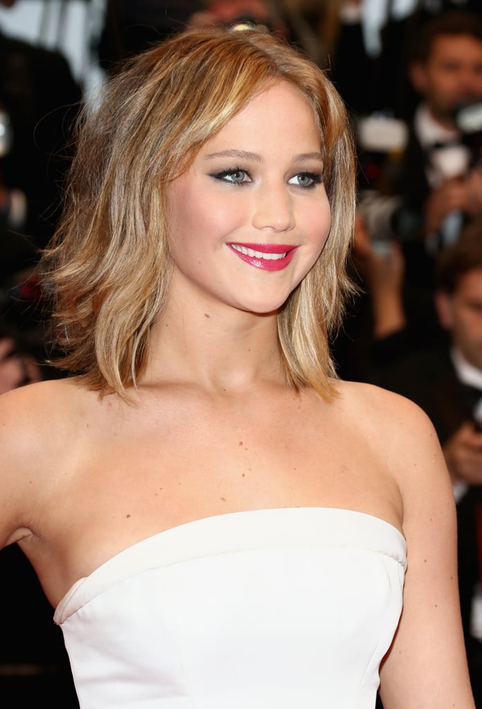 Sexy! Jennifer Lawrence went for all-out glam with raspberry-red lips and bronzed skin.