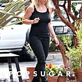 Britney Spears wore tight black pants and a black tank top.