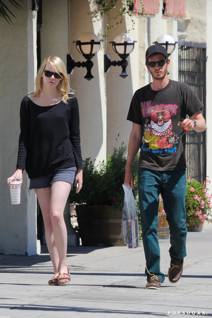 Emma Stone and Andrew Garfield spent a low-key afternoon in LA yesterday. The couple drove through In-N-Out and were also seen stopping by the Samuel French bookstore, which is known for its selection of plays and publications about acting and film. Andrew, who was wearing a Homey the Clown t-shirt, left with a bagful of books after the visit. The outing was the latest for The Amazing Spider-Man costars and real-life couple, who just last week paid a visit to Disneyland and celebrated Andrew's 29th birthday. Emma and Andrew showed PDA as they marked Andrew's big day by the beach in Malibu.  Emma will have some unexpected downtime from work this Fall, with Gangster Squad's release date having recently been pushed from this September to 2013. The change came after Emma posed for the current cover of Interview magazine to promote the project.