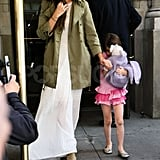 Katie Holmes held daughter Suri Cruise's hand on her 6th birthday as they left their NYC apartment.