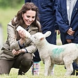 She fed a lamb during her visit to Farms for City Children in May.