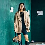 Aimee Song with a Louis Vuitton bag and Tibi boots.