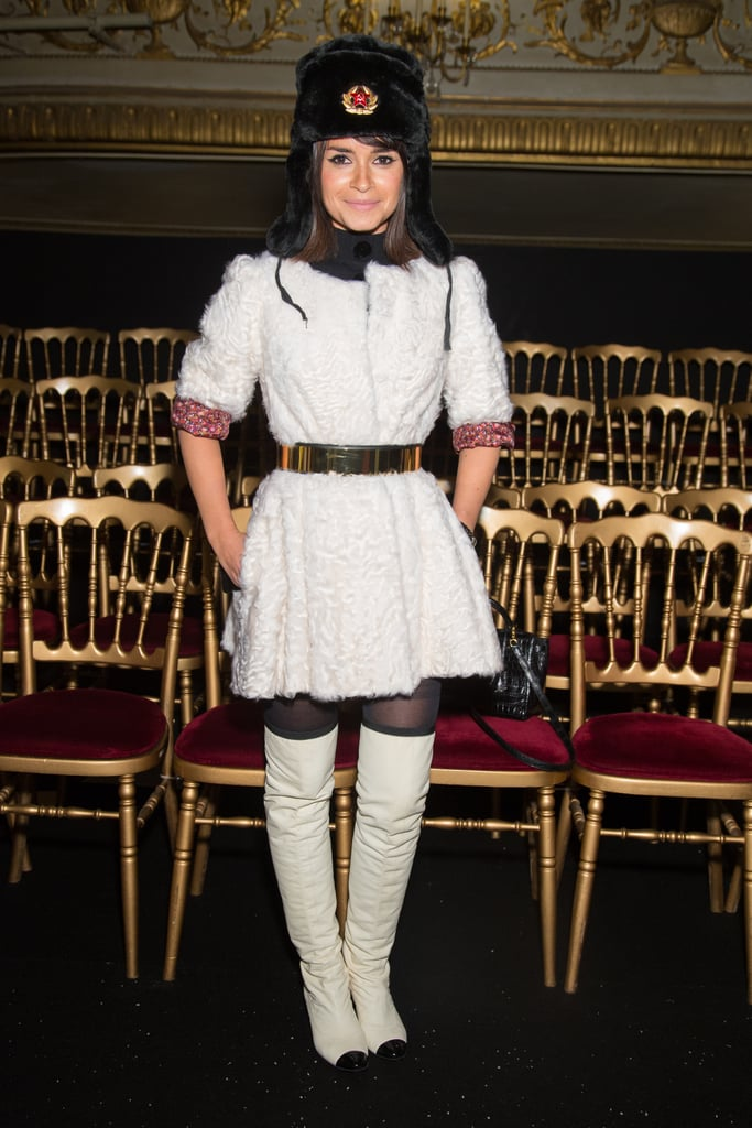 Miroslava Duma went all out in a white shearling coat, Chanel over-the-knee boots, and a fur trapper hat.