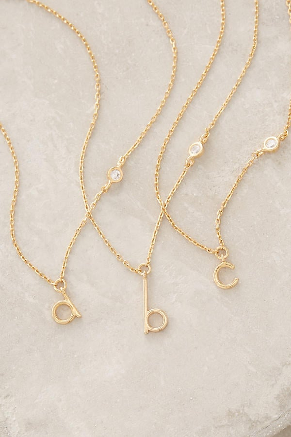 This monogram initial necklace from Anthropologie ($38) will dress up everything in your mom's closet but effortlessly so.