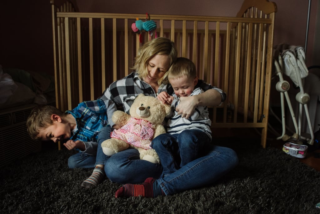 """""""I've heard from many families who've experienced loss that family photos are really hard. How do you take a photo of your family when one member is forever missing? The Molly Bear is a way to remember Abby in this photo."""""""