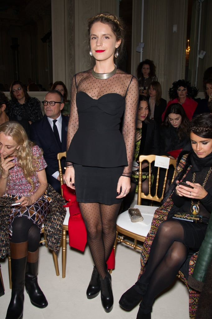 Eugenie Niarchos attended Valentino's show in a sheer dotted LBD, then coordinated her dotted tights with her top half.