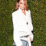 We can't help but think Nicole Richie was playing up her wild side with the flipped-out hair and inky smoky eye. And that over-the-eye bang . . . how mysterious!