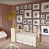 The gallery wall behind Atlas's crib is covered in superspecial black-and-white photos of family and friends.