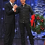 Tom Cruise held onto a wreath and Jimmy Fallon's hand.