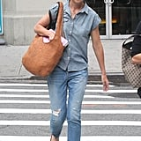 Katie Holmes sported brown flats and shades.