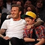 David and Brooklyn Beckham at the Lakers game.