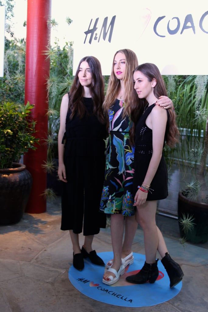 The Haim sisters set just the right tone at the H&M party. While Danielle and Alana chose easy all-black outfits, Este stood tall in a lovely printed dress and eye-catching sandals.