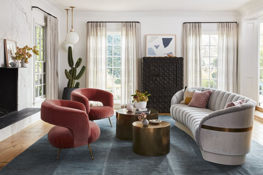 """The design team achieved this funky, elegant living room look by mixing velvet retro chairs with a timeless sofa. """"It was a balancing act,"""" Zwickl told Better Homes & Gardens. """"The key was merging all the elements together and keeping scale in mind."""""""