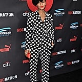 Janelle matched her polka-dot suit to her killer pumps and finished her look off with fiery red accessories.