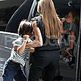 Angelina helped Pax into the car.