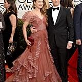 Andy Samberg kept his arm around Joanna Newsom on the red carpet.