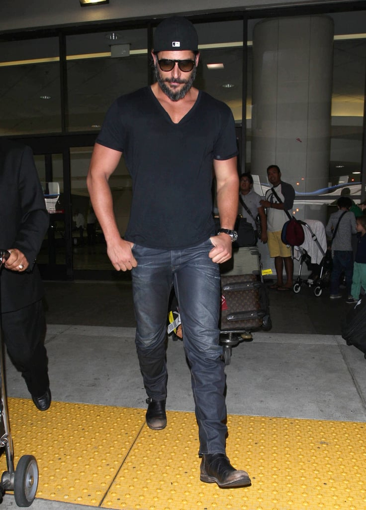 Joe Manganiello had help with his luggage as he made his way out of LAX yesterday. He showed off scruffy facial hair and covered up his fit physique in a V-neck. Joe's muscular body landed him in first place in our 2012 Shirtless Bracket, beating out stars Zac Efron and Robert Pattinson for the title. Joe recently wrapped work on True Blood after the dramatic season finale last month, but he'll soon get started on other projects. He'll guest star on How I Met Your Mother and will also show his support at a Stand Up to Cancer telethon on Friday.