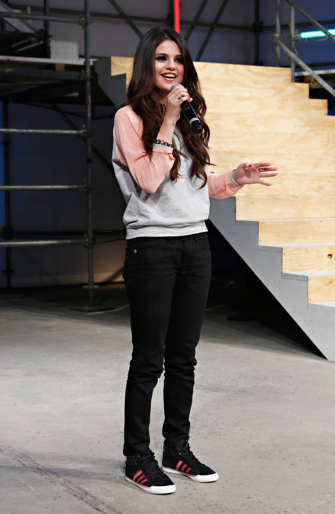 """Selena Gomez was front row at the Adidas NEO fashion show in NYC last night. She later jumped on stage to talk to the audience after the presentation had wrapped. While speaking to the show's attendees, Selena thanked the teen bloggers who she and Adidas tasked with styling the show. This is Selena's first show with Adidas after signing on to be its style ambassador back in November. The event wasn't without some drama, as Selena was ambushed by anti-sweatshop protesters. One protester handed out fliers that read """"Selena Gomez: Be an ambassador for children, not sweatshops,"""" referring to Selena's involvement with UNICEF. The protesters' sweatshop claims didn't appear to bother Selena, as she tweeted after the event that it was an """"amazing show."""""""
