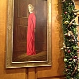 Former First Lady Nancy Reagan has a portrait, in which she's appropriately wearing red, hanging near the entry.