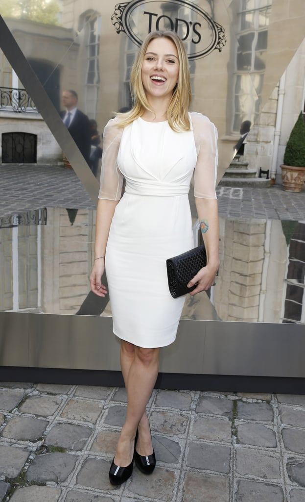 """Scarlett Johansson got fashionable in a white Dior dress with sheer sleeves to stop by a Tod's party during Paris Fashion Week last night. She posed for pictures with Tod's CEO, Diego Della Valle, while checking out new handbags at Paris's Italian Embassy. Scarlett spoke about her famous curves to WWD at the event, saying, """"I think every girl has their difficult part of their body that's difficult to dress. For me, it's always been about being petite and curvy. There are certain styles I'd love to wear, but I just have to come to terms with the fact that I just don't look good in like a sack dress, it's just not going to happen. . . . As you get older you learn more about your body and what looks good on you. It's weird for me, because I've been photographed for so long . . . and sometimes you look back at those red-carpet pictures, and you're like, 'What was I thinking?' I think everyone has that, maybe not on that scale, but everybody has their shameful red-carpet moment."""" The star has been in France for the past month spending time with boyfriend Nate Naylor and getting acquainted with the area. Last month, Scarlett and Nate explored the city together during a jog, and she also recently stopped by a Parisian market and the Saint Laurent boutique for some shopping. Her time in the City of Light will soon come to an end since she'll be back on Broadway in January. Scarlett will return stateside to take up her role as Maggie in Cat on a Hot Tin Roof."""