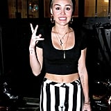 Miley Cyrus threw up a peace sign leaving a video shoot in LA.