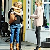 Cameron Diaz and Stella McCartney greeted a friend.
