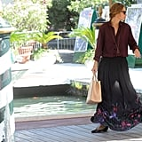 Kasia Smutniak is the master of maxi skirt style — her latest floral iteration goes perfectly with a darker merlot-hued silk blouse and long gold chain necklace.