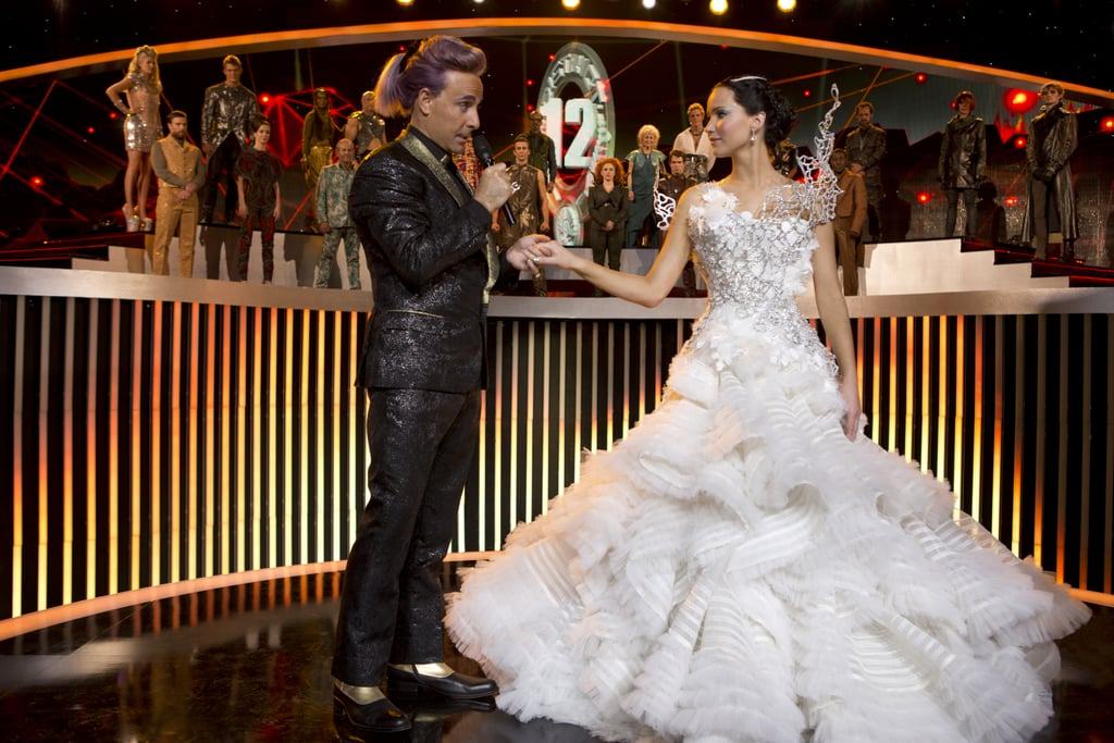 Stanley Tucci as Caesar Flickerman and Jennifer Lawrence as Katniss in Catching Fire.