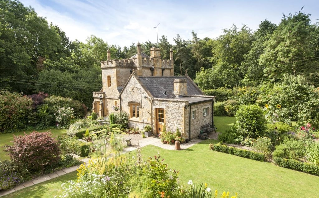 The world is already obsessed with tiny houses — myself, especially since Coyote on Grace and Frankie bought himself one — but this tiny castle in the UK is downright adorable.  Known as Molly's Lodge (even more adorable), this nineteenth-century gate lodge is sitting on 0.61 acres of land, in the heart of England and on the market for £550,000 (about $902,000) — so, cheaper than most Sydney apartments.  Molly's lodge is surrounded by lush gardens (they look like something Beatrix Potter wrote), an orchard and little pond. Inside, there's a wrought iron spiral staircase, fireplace, separate bedroom in the annexe and two reception rooms, you know, for receiving your guests. It's on the small side when it comes to royal living, but most of us would happily settle to be queen of this castle.      Related:                                                                Live Like Belle: 13 Real-Life Castles You Can Spend the Night In                                                                   This 18-Square-Metre Tiny House Is as Luxurious as a Mansion