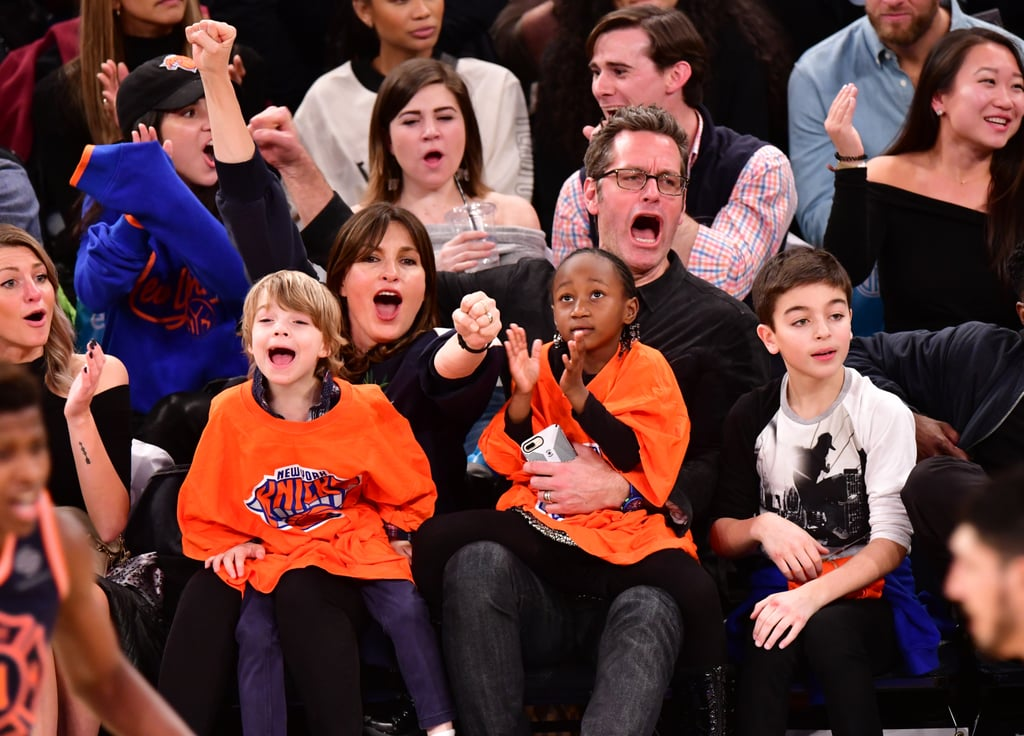Peter Hermann and Mariska Hargitay took their three beautiful children — 11-year-old son August, 6-year-old son Andrew, and 6-year-old daughter Amaya — to watch the New York Knicks take on the Boston Celtics at NYC's Madison Square Garden on Feb. 24, and we're still not over this adorable outing. Not only did the family show off their team spirit as they collectively cheered from the sidelines, but Andrew and Amaya were as cute as can be in their oversize matching Knicks t-shirts.  Peter and Mariska have a lot to celebrate lately; Peter is gearing up for the March 13 release of his children's book, If the S in Moose Comes Loose, while Mariska's new documentary, I Am Evidence, premieres on HBO on April 16. The longtime couple will also be ringing in their 14-year wedding anniversary on Aug. 28.