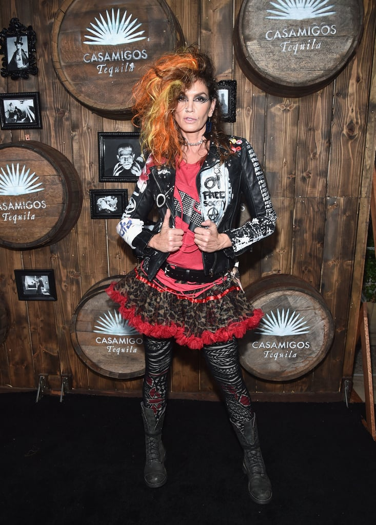 Cindy Wore a Graphic Leather Jacket, Pink Top, Printed Tutu, and Patterned Tights