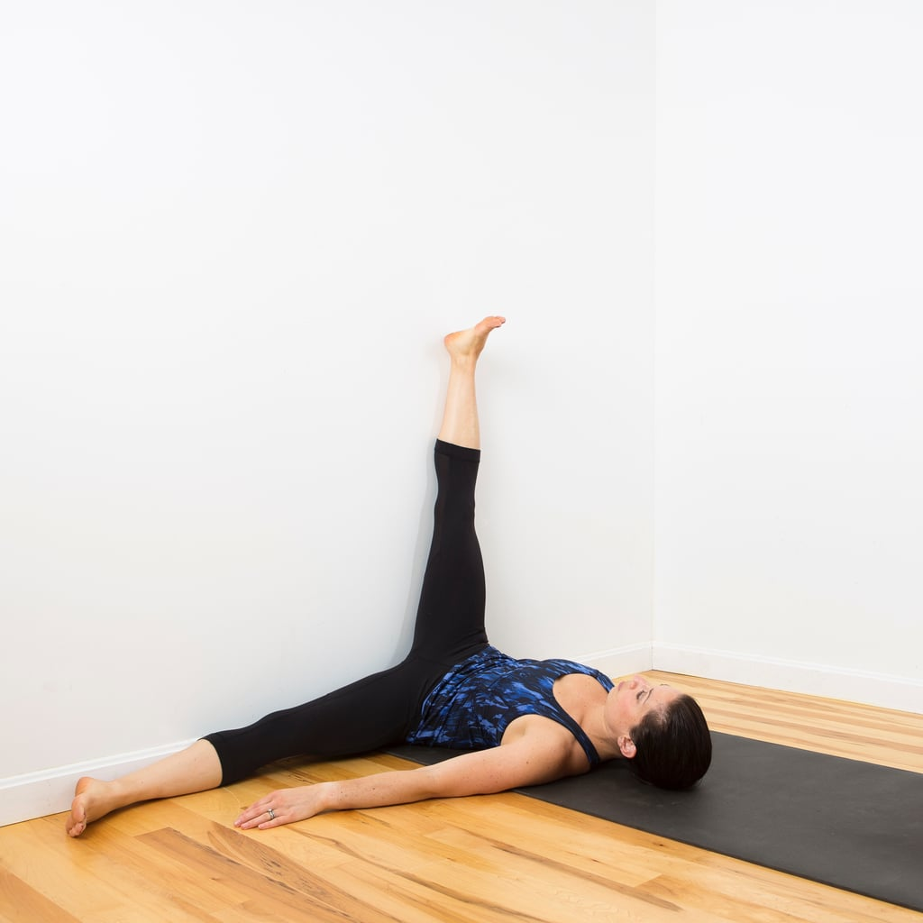 Relaxing wall yoga sequence popsugar fitness for Floor yoga stretches