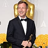Spike Jonze smiled after winning best original screenplay for Her.