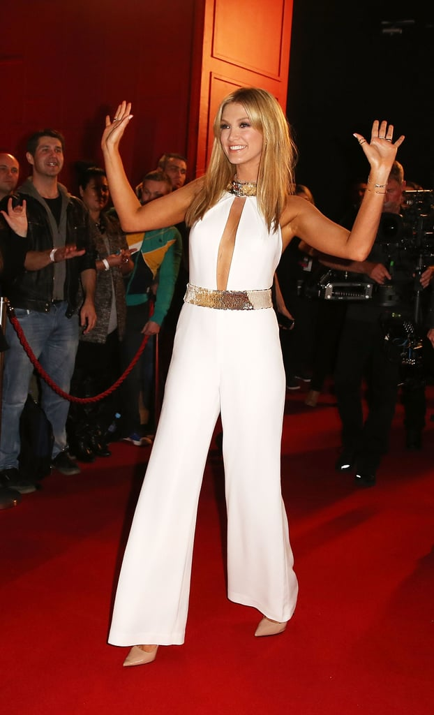 Hands in the air! Delta was beaming when she arrived at The Voice's cocktail event for Coldplay in June 2014.
